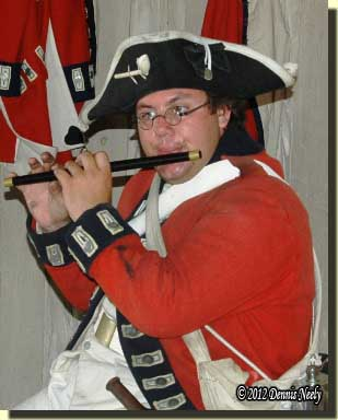 A British soldier from the King's 8th plays the fife.
