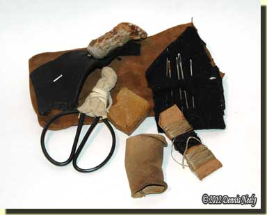 A woodland sewing kit kept in a small leather pouch.