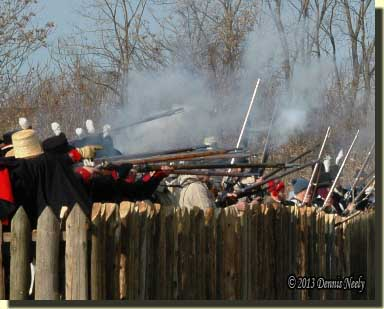 Winchester's troops fire from behind Frenchtown's north fence.