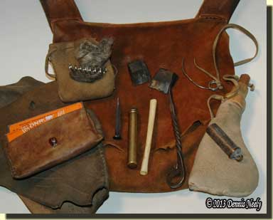 The contents of the shooting pouch displayed.