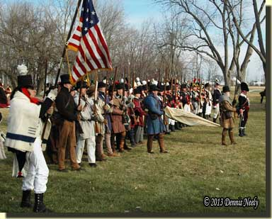 A line of militiamen stand at attention.