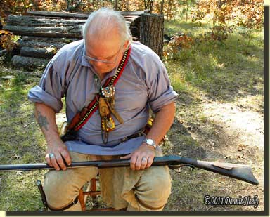 Ted Jayson pointing out some rasp marks on the rifle's stock.