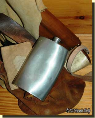 The Northwest gun, shot pouch, horn, pewter flask and walnut meats.