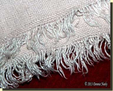 The frayed hem's fringe was once considered period-correct, but now represented poor research.