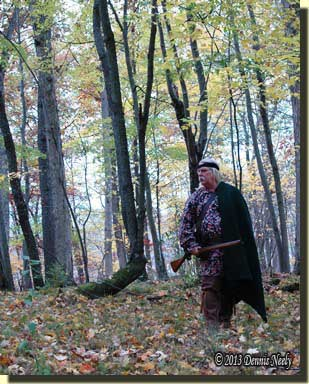 With a blanket draped over his left shoulder, the woodsman slilps away.