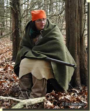 Tami Neely sitting as she watches for deer to the west.