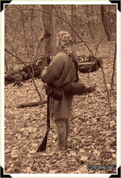 Traditional woodsman Jon Hollenbeck paused to take in the beauty of the forest during an October squirrel hunt. New France, 1753.