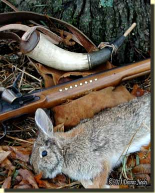 The powder horn, shot bag, Northwest gun and a cottontail rabbit.