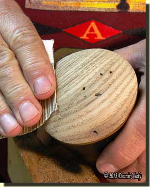 Sanding a wormy chestnut plug in a powder horn