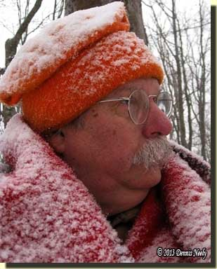 Snow covers a traditional woodsman.