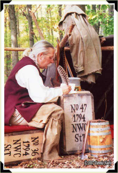 A traditional woodsman writing in his journal.