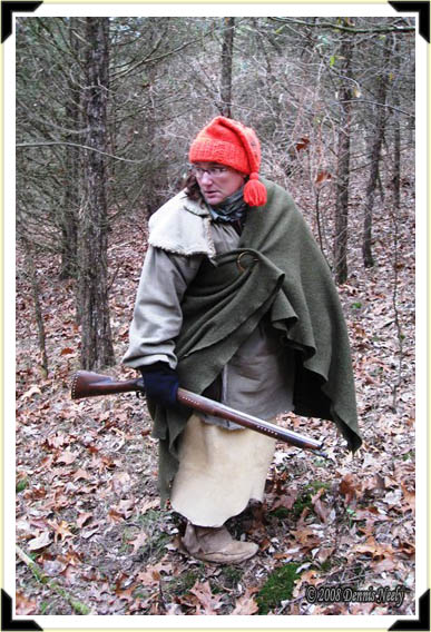 Wrapped in a green trade blanket, a lady of the woods checks her back trail.
