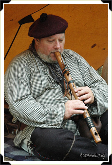 Charlie Brown playing his Native American flute in camp.