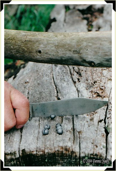 Spliting buckshot with a trade knife.