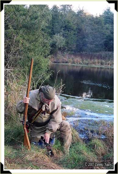 A traditional woodsman retrieving a wood duck drake.