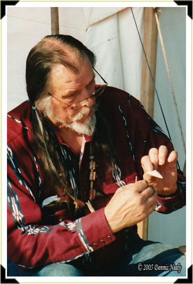 Traditional archer Norm Blaker showing a finished arrow head.