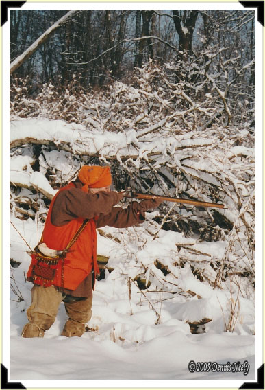 A traditional woodsman taking aim at a fleeing cottontail rabbit.