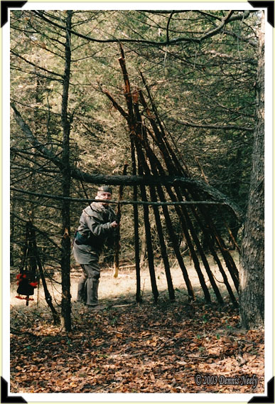 Traditional woodsman, Dennis Neely, places a cedar rafter on the duck camp.