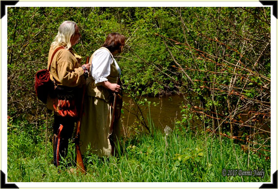 Living historians, Dennis and Tamara Neely, standing beside the Pigeon River.