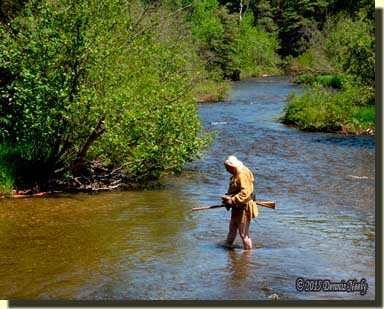A traditional woodsman mid-stream in the Pigeon River near Vanderbilt, Michigan.