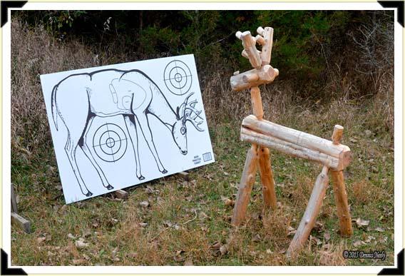 A cedar-twig deer looking at a cardboard deer target.