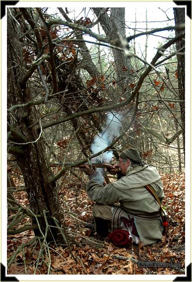 Traditional woodsman Dennis Neely firing Northwest gun at a wild turkey.