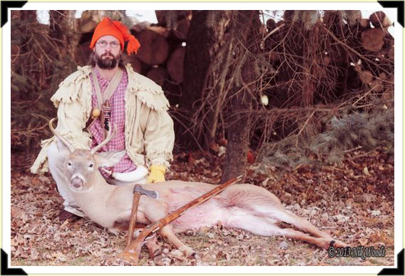 Traditional hunter Nik Woods with a fine 5-point buck.