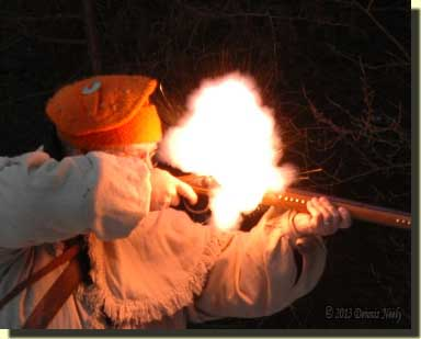 A flintlock's pan flash right at dusk.