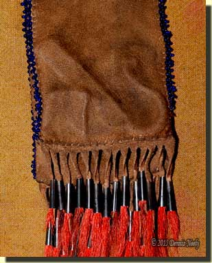 The outline of the flint and steel seen through the buckskin.