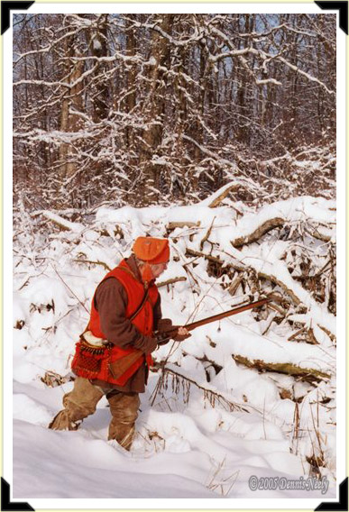 An 18th-century woodsman approaching a snowy brush pile