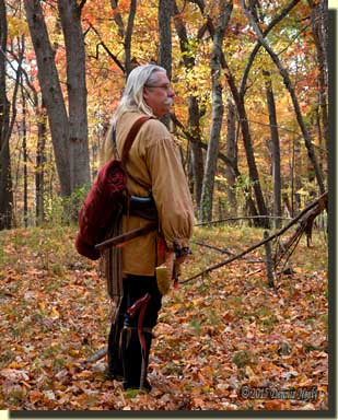 A traditional woodsman pauses before choosing the next path.