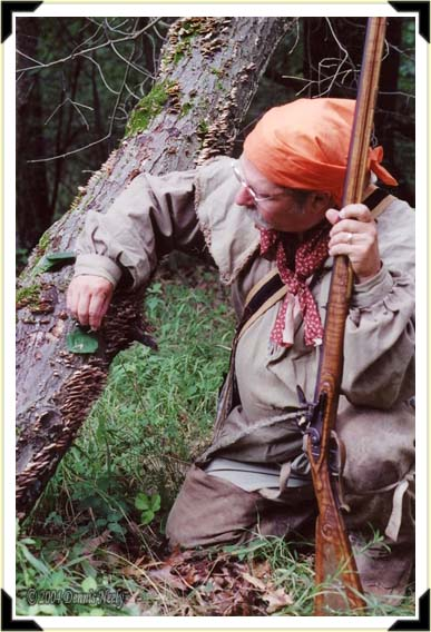 A traditional woodsman hunting fox squirrels with a Dickert rifle.