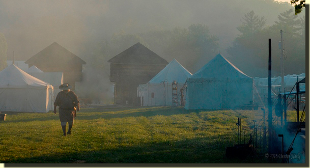 A lone woodsman walks in the morning haze at Frienship, IN.