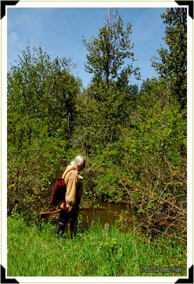 A traditional woodsman walking  up on the Pigeon River.