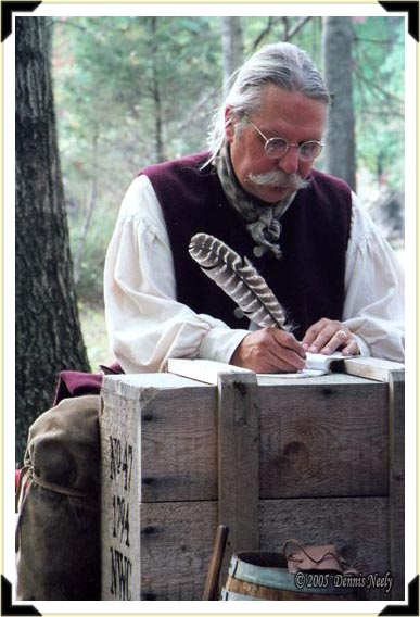 A traditional woodsman writes in his journal.
