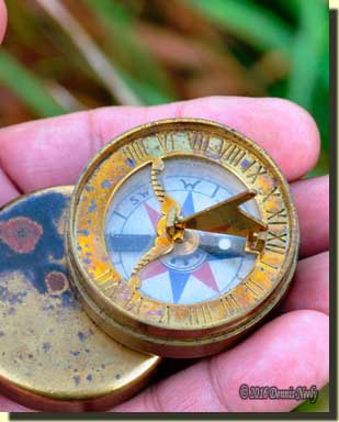 A reproduction of an 18th-century brass compass.