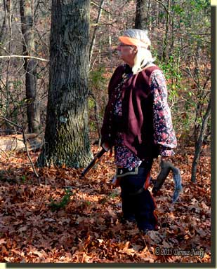 A returned white captive hunter watches three fox squirrels on a far knob.