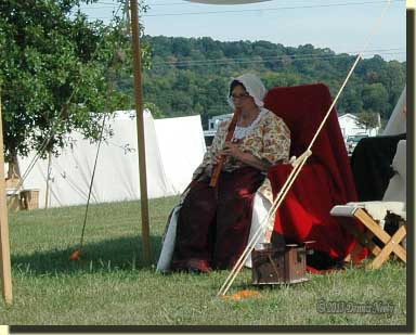 A lady of the forest playing her Native American love flute at Friendship, Indiana.