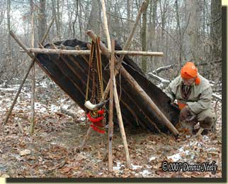 Tying the oil cloth to cedar rafters