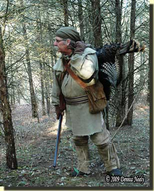My alter ego with a wild turkey slung over his shoulder.