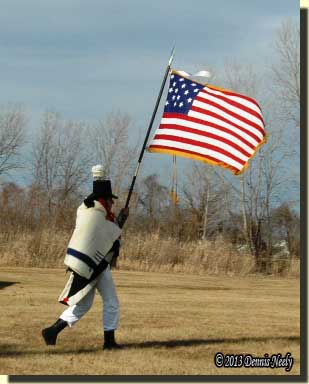 A member of Lacroix's militia caries an 1812 American flag into battle.