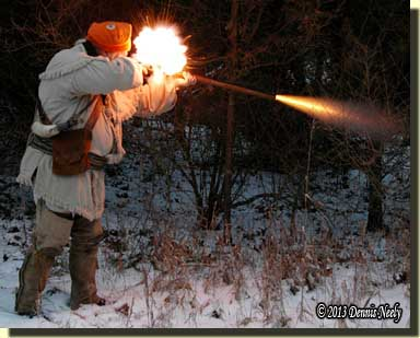 In waning light, the Northwest gun's pan flashed and the muzzle belched fire.