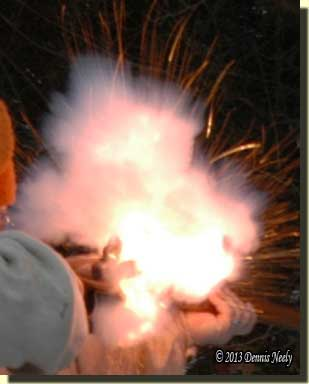 Sparks fly as the flintlock ignites.