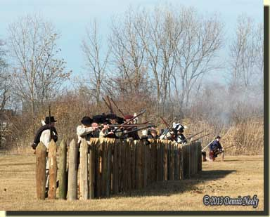 A mid-battle volley of musket fire at the Frenchtown fence.