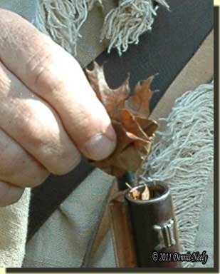 Pushing dry oak leaves down the Northwest gun's muzzle.