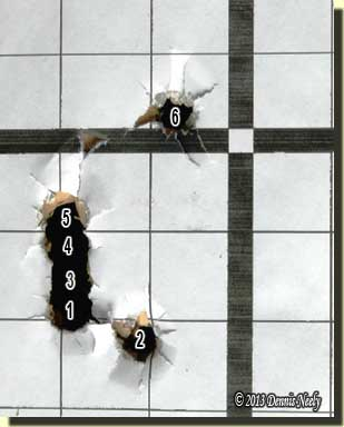 A sighting-in target showing the six shots.