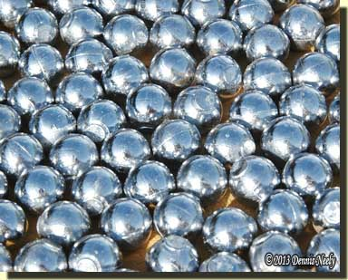 Lead balls shining in the sun.