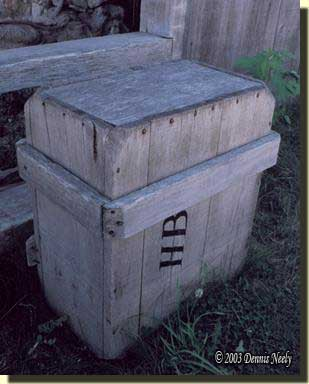 The gray crate sitting near the French Chimney.