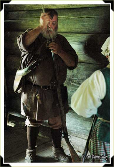 Fred Martin loads his longrifle in defense of defending Fort Greeneville