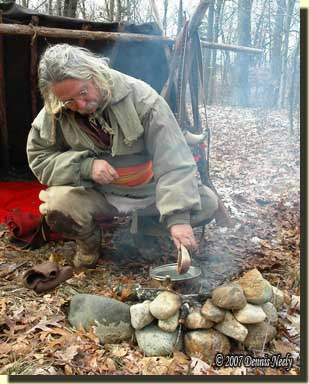 A traditional woodsman stirring soup in a brass kettle.